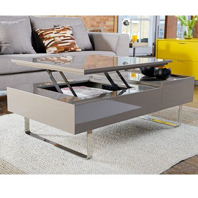 A Sleek Gloss Lacquer Design With Elevating Surface Which Reveals Storage For Your Books Coffee Table