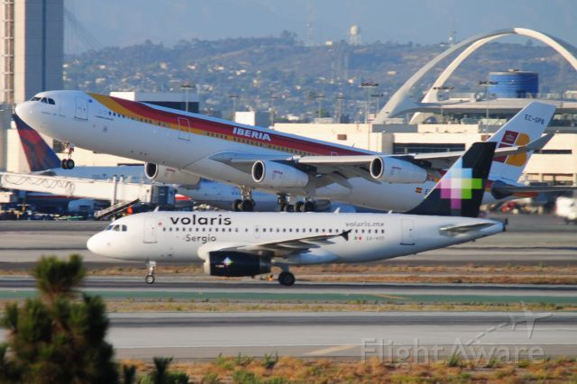 Volaris A319 at LAX with Iberia A340-300 departing ...