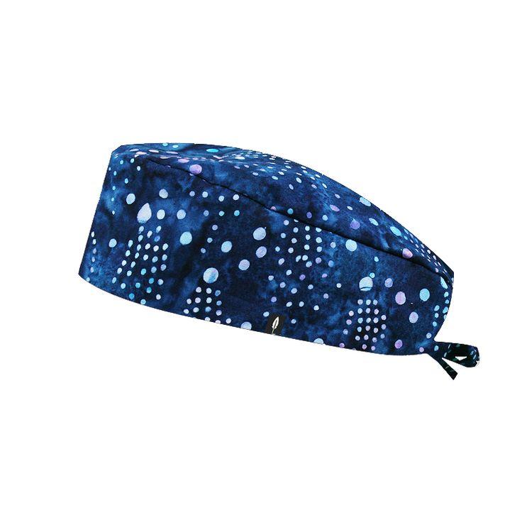 Elegante gorro de quirófano Robin Hat en tonos azules batik para pelo corto. Este tejido está confeccionado mediante la técnica batik de Indonesia.