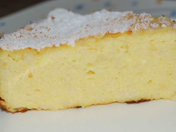 Tort cu gris  250 grame gris 1 litru lapte 1 plic zahar vanilat Cateva bucati de unt 6 oua 200 grame zahar 400 grame branza ricotta Coaja de lamaie Coaja de portocala Coaja rasa de lamaie Un varf de sare