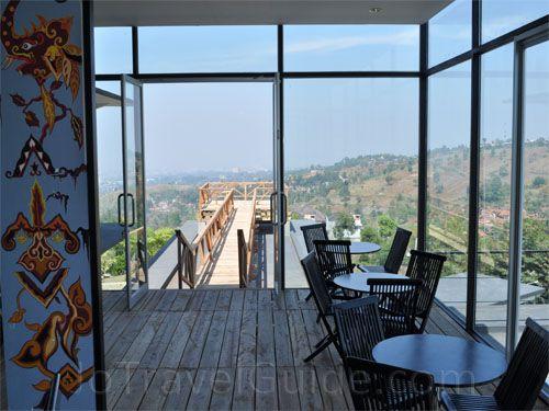 A wooden balcony at Lawangwangi Bistro Cafe