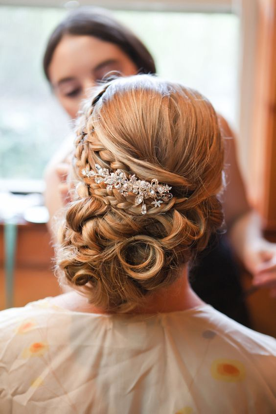 Elegant low updo wedding hairstyle with glam diamond hairpiece; Featured Photographer: Addison Studios