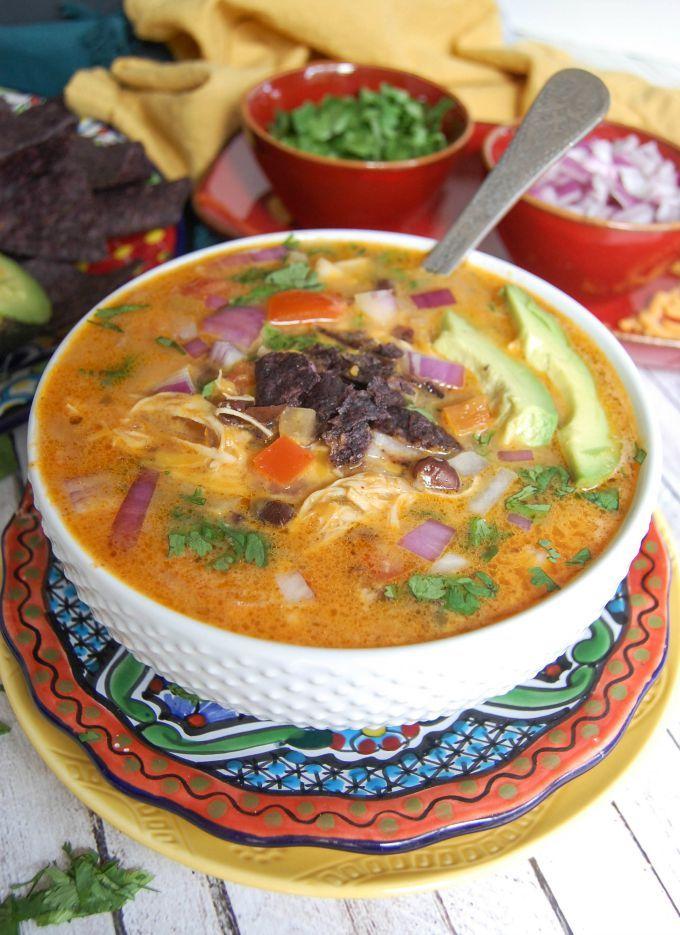Slow Cooker Mexican Cheesy Chicken Soup; a cheesy chicken tortilla soup made in the slow cooker is easy and delicious. // A Cedar Spoon #ad #CrystalFarmsCheese