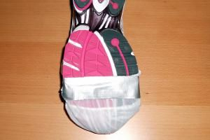 How to Use a Shower Cap to Keep Your Shoes Dry Walking: Shower Cap Shoe Cover Secured with Duct Tape - Sole View