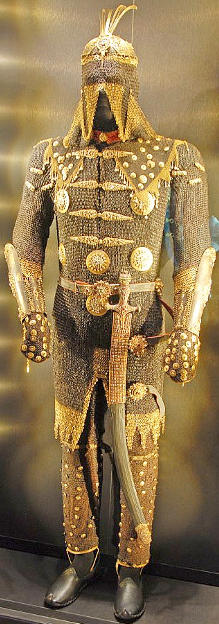 Ottoman Empire armor belonging to Sultan Mustafa III consisting of migfer (helmet), zirah (mail shirt), mail trousers, kolluk/bazu band (vambrace/arm guards), shamshir (sabre), decorated with gold and encrusted with jewels, 18th century, exhibited in the Imperial Treasury of Topkapi Palace, Istanbul, Turkey.