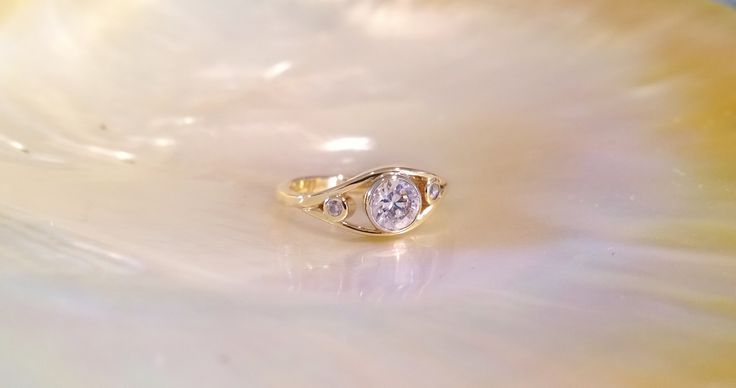 Made with old gold ring and diamonds of the customer.