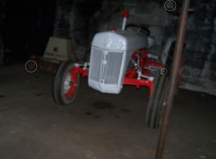 One of the most reportedly haunted buildings at the Anna Dean Farm...new tractor batteries keep losing their charge...I only got a few pictures because the new batteries in my camera died. Circled: (what I believe to be) orbs