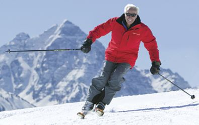 Klaus skiing the ridge of Tiehack, Buttermilk Mountain with Pyramid Peak in the background. Klaus, now 93 years young, enjoys skiing everyday of the season.