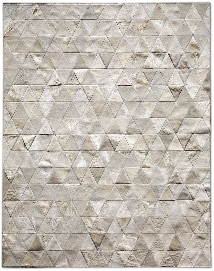 Kahn Cowhide Rug (Ivory) - Perfect for underneath the coffee table in an urban loft