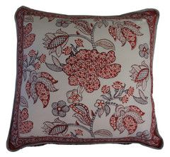 Printed natural cotton cushion featuring a bold tulip design in red, natural, taupe and grey. Each section of the floral design fetaures a different decorative print. The reverse has a complimenting repeated floral design in the same colours.  Hand block printed in India using ethical & environmentally friendly construction that preserves and celebrates traditional artisan skills.  100% natural cotton cover with NZ made Polyfill inner.  Dimensions: 45cm x 45cm