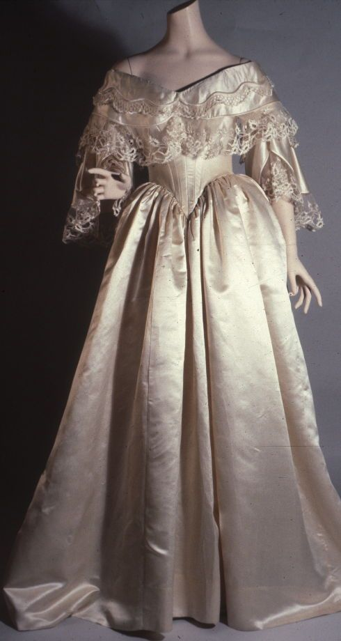 Wedding dress Date: 1858 Media: Silk Satin And Lace Country: United States Accession Number: 41.13.5 One piece white satin dress with boned bodice. Two-layer cape collar edged with lace flounces. Two layer full sleeves also trimmed with lace. Full, plain skirt, bodice laces at back.