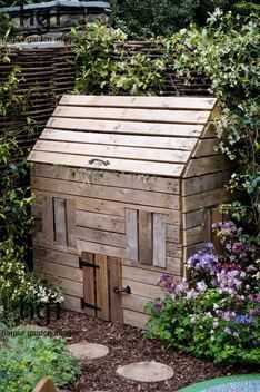 """compost bin made to look like a """"Wendy House"""" -- homemade DIY weekend project - Designers: Jenny Wisby Sharon Kent - Sponsor: Southdowns Nurseries Sheddingdean Primary School RHS Chelsea Flower Show 2005"""