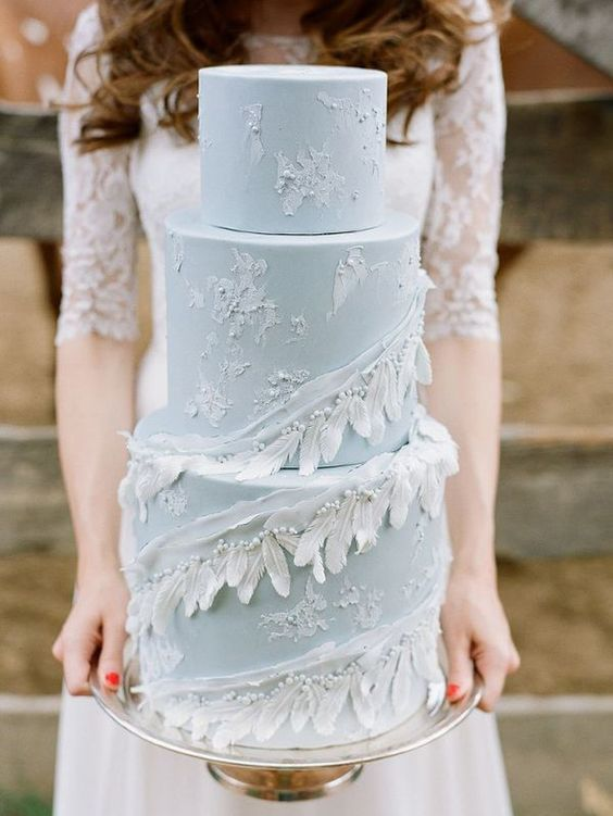 Sensational pastel blue wedding cake with feather details