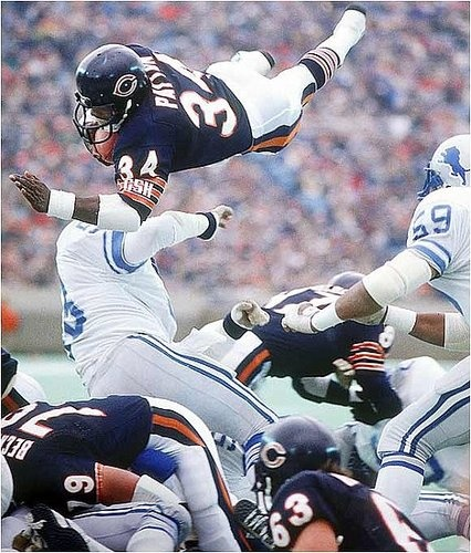 Walter Payton leaping over everybody!!!!