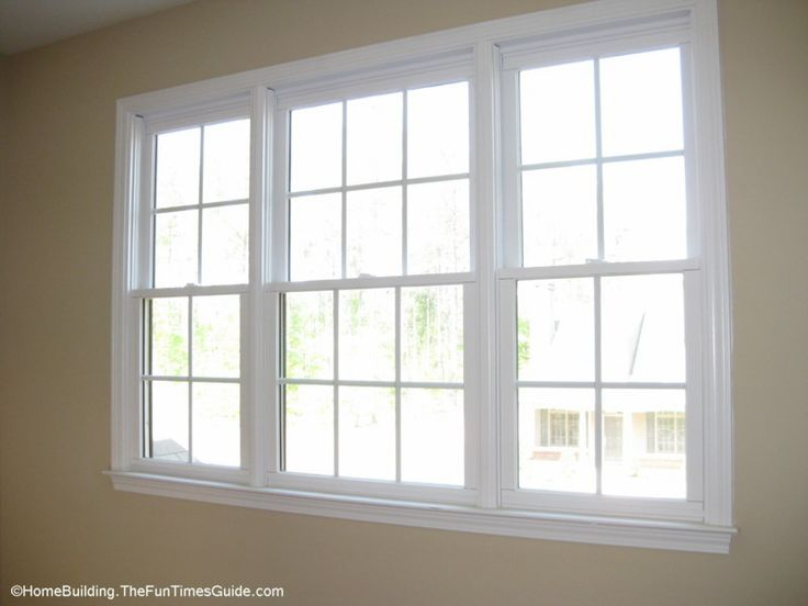 2 and 3-wide units of double hung windows with colonial grill to coordinate with the large front window on the house