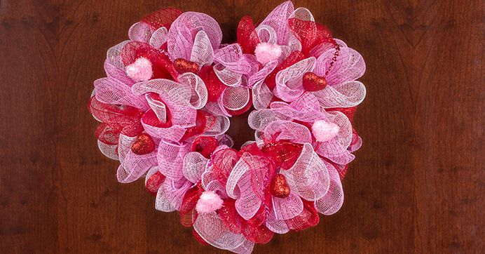 Put your heart on display this Valentine's Day! Craft a lovable deco mesh heart wreath using $1 supplies from Dollar Tree.
