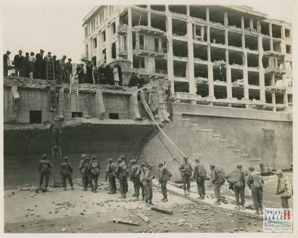 WWII in Italy - 85th Division crossing the river Adige in Verona over the destroyed Ponte Della Vittoria on 25 April 1945. | The Digital Collections of the National WWII Museum : Oral Histories