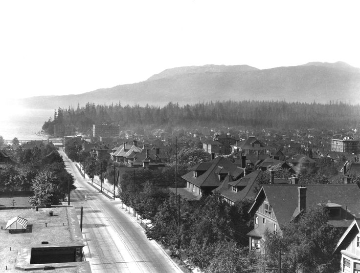 West End.  Looking west on Davie Street VPL Accession Number: 8459 Date: 192- Photographer/Studio: Broadbridge, R. Content: Looking west on Davie Street from Jervis towards English Bay, trees in Stanley Park and North Shore mountains. http://www3.vpl.ca/spe/histphotos/
