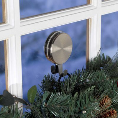 Double Magnetic Wreath Hanger...the Double Magnetic Wreath Hanger holds tight, indoors or out. Place one of the magnetic hangers (you get 2) on your steel door to hold a wreath or other decoration.