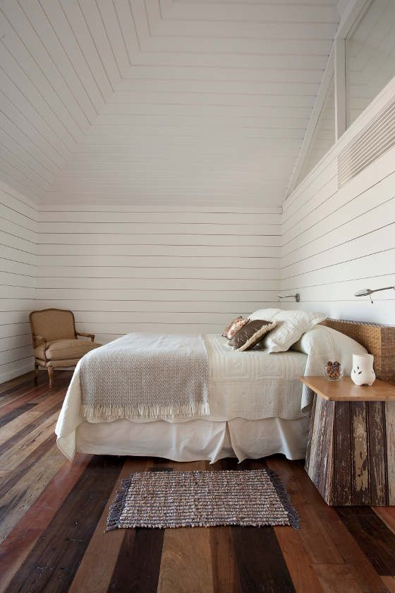 Less is more in this beach house bedroom, with the boarded wall cladding making all the statement that needs to be made.