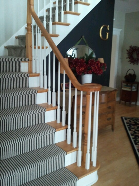 Black and natural stripe runner on stairs