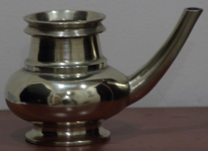 Kindi is a type of a pitcher usually found in old houses in Kerala and other parts of India.  Usually made of bell metal, it is commonly used during Puja to dispense holy water.   Kindi is also used to keep water at the entrance of the house, so that visitors can wash their feet with this water, and also to wash hands after meals.