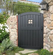 Painted or Stained wooden gate with window and curved top