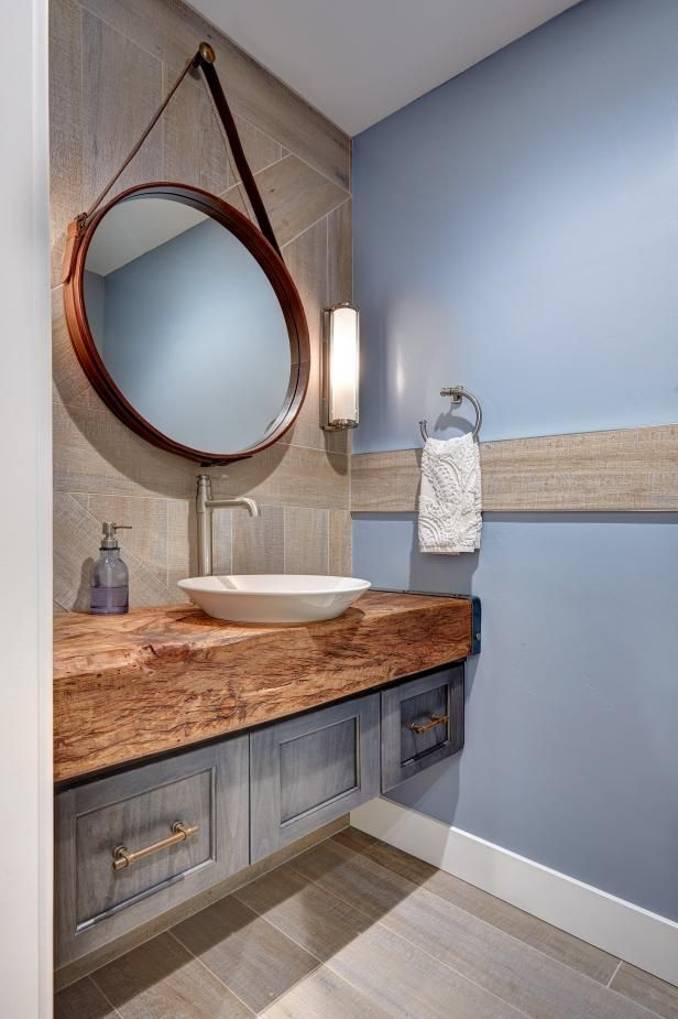 Iconoclastic bathroom mirrors are still a hot design trend for 2016.  See more design trends you can pull off in a weekend >> http://www.diynetwork.com/made-and-remade/learn-it/design-trends-you-can-pull-off-in-a-weekend?soc=pinterest