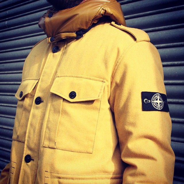 A must have for any Stone Island jacket collector- New for this season- wool blend Ice Jacket in mustard. The wool and polyester mix fabric has undergone a thermo-chromatic resin treatment enabling colour changes according to temperature variations.