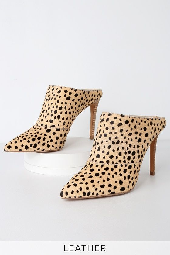 8beb7838e4 Look sharp in the Dolce Vita Cinda Leopard Print Calf Hair Pointed Toe Mules!  Fuzzy genuine calf hair, in a cool leopard print pattern, stuns across the  ...