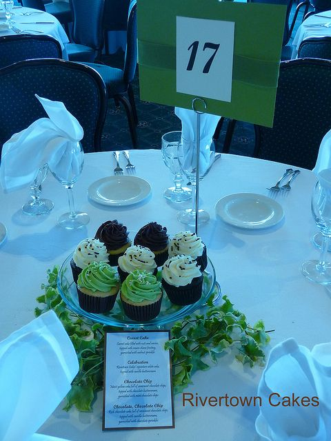 082810 - Cupcake Centerpiece Wedding by Rivertown Cakes, via Flickr-now there's an idea; instead of one big display, put enough cupcakes for the table as a centerpiece, and just display the tiers for cutting