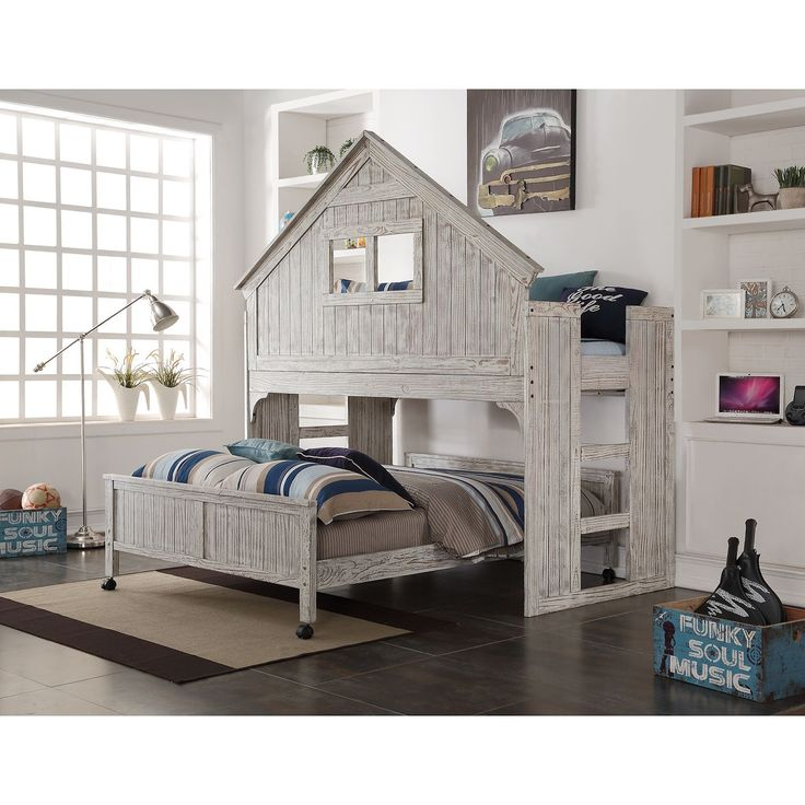 Your kids can sleep and play in decorative flair wit this Club House Low Loft from Donco Kids. This loft features a roof-like construction detail and comes with a full-size caster bed.