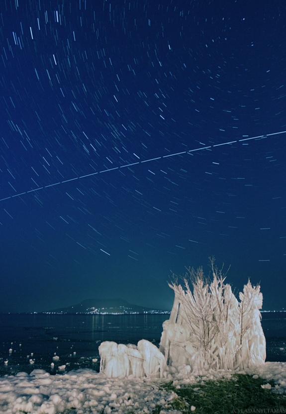 The International Space Station trails over the sky in this image taken in frozen Lake Batalon, Hungary. Skywatcher Tamas Ladanyi of the The World At Night (TWAN) took this photo over the lake on a frozen night in February 2011 during the final flight of space shuttle Discovery.