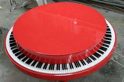 Round piano made for Target commercial played on by Alicia Keys - This looks a lot like one of my drawings! Except there's no tree growing in the middle of this piano. :))