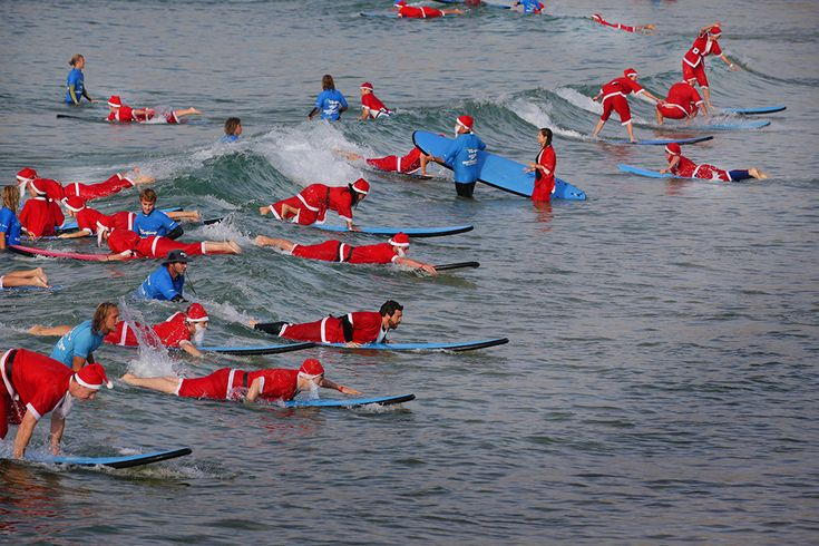 Hundreds Of Santas Broke The World Record For Largest Surfing Lesson