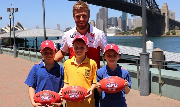 """A group of boys from St Aloysius College in Sydney were thrilled to meet Sydney Swans star Kieren Jack at Luna Park on Monday as part of the Australia Post AFL Community Camp."" #GoSwans #AFL #AFLCommunityCamp"