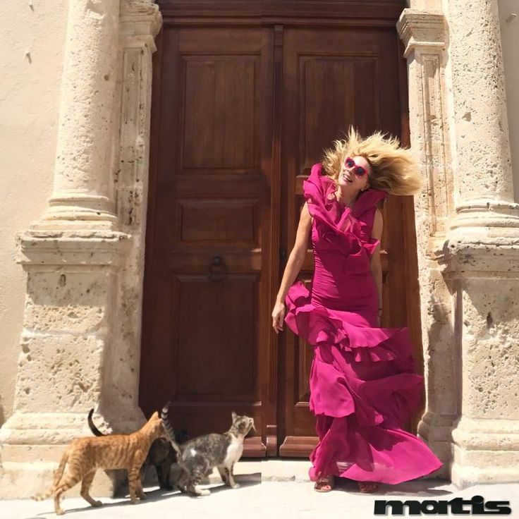 Feeling stylish enough in a fuchsia maxi dress...