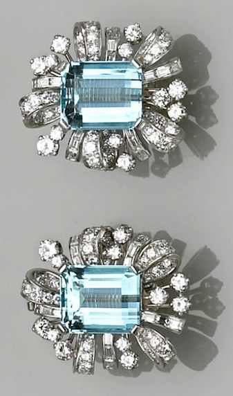 Aquamarine, diamond and platinum earrings, ca. 1950 - each earclip centering a rectangular-cut aquamarine within a ribbon-like spray of round brilliant and baguette-cut diamonds; estimated total aquamarine weight: 12.30 carats; estimated total diamond weight for the pair: 4.80 carats.