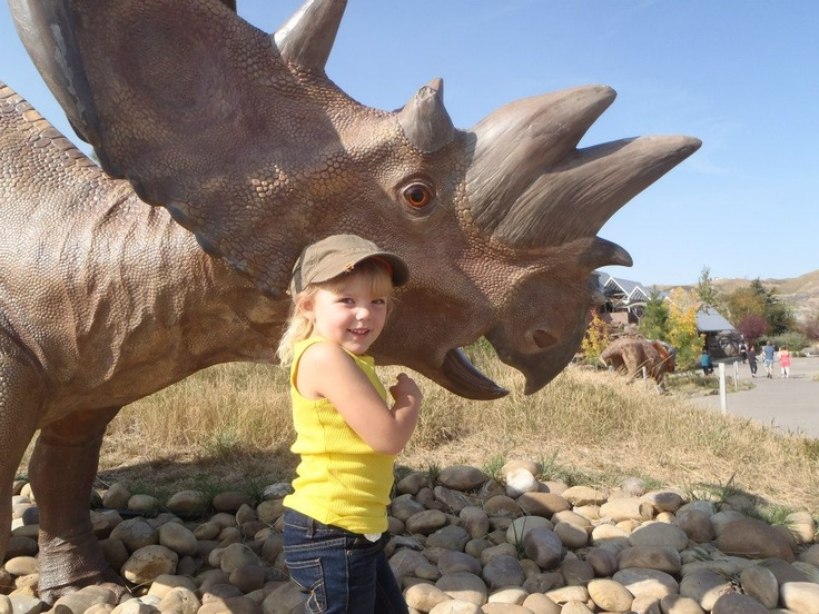 My granddaughter hanging with the dinosaurs