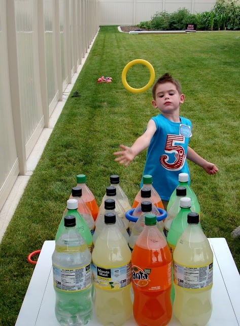 Best EVER Carnival Party & Game Ideas! {Ring Toss, Fish Pond, Spill the Milk, & More...} hit the local stores for sales on their 2 liters. In bright flvors and colors like big red orange lemon lime etc...buy a diving ring set ,usually 3 or 4 in a set, at the dollar store