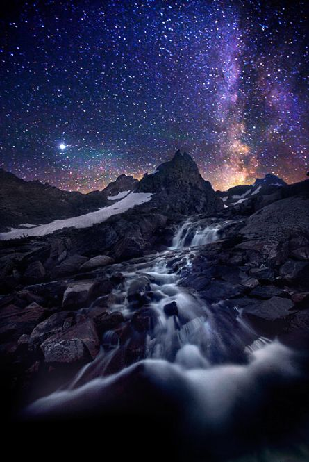 Awesome Photoshop of The Milky Way cascading into the mountain stream. Beautiful work!