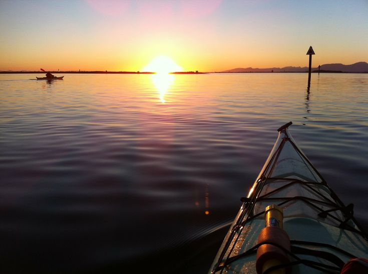Kayaking at Crescent Beach in South Surrey. It is the perfect spot to paddle into the sunset.