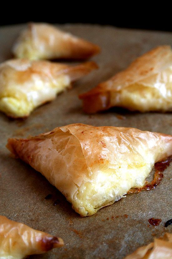 Tiropitas, cheese-and-egg filled fillo triangles, are always a party favorite. What's more, they can be made ahead and stashed in the freezer — perfect to have on hand for entertaining.