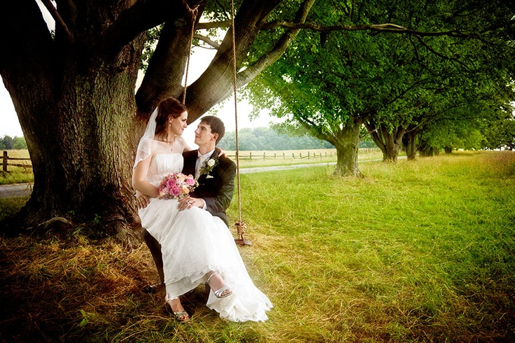 Bride and Groom cuddle up on a tree swing in Knox Park, East Aurora, New York