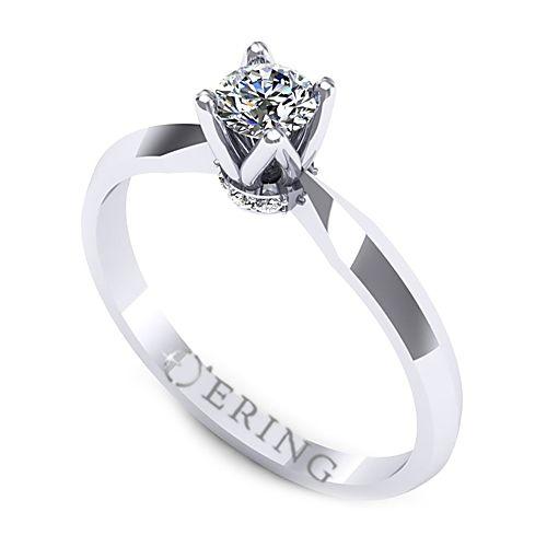 Inelul este realizat din aur alb 14k, greutate: ~2.10gr.                                     Produsul are in componenta sa: 1 x diamant, dimensiune: ~3.70mm, greutate: 0.20ct , culoare: G, claritate: VS2, forma: round 6 x diamant, dimensiune: ~1.10mm, greutate totala: ~0.04ct, forma: round