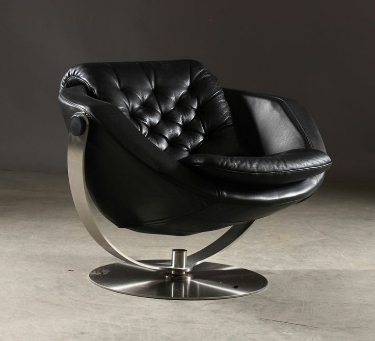 The Moon Alpha Chair deLux version. Black leather on a floating laser cut stainless steel frame. Art or furniture?