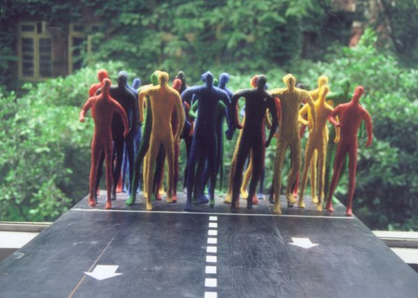 Runners - installation sculpture of running people by contemporary Chinese sculptor Zhang Yaxi