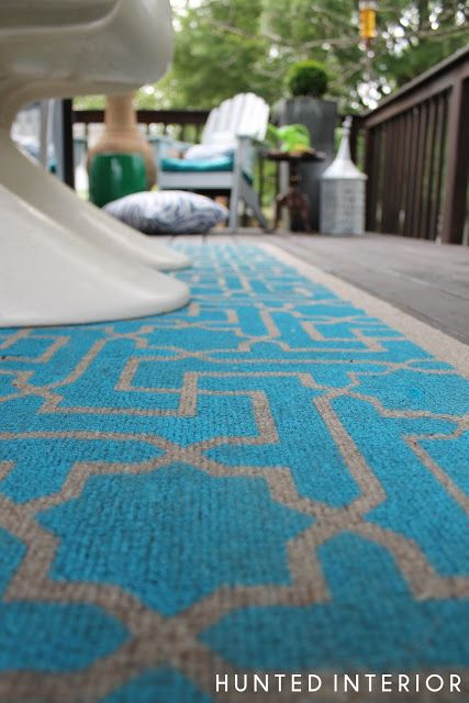 Spray paint stencil on cheap outdoor rug from Lowe's or Home Depot using a bright, beachy blue! Will need 2 rugs for our patio and probably 6+ cans of paint.