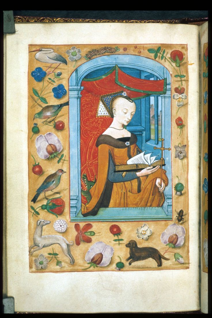 """""""Miniature of Margaret standing under a canopy holding an open book and a cross, with a dragon's head behind her, and a scatter border including rosebuds, strawberries, forget-me-nots, birds, dogs, and insects."""", """"Book of Hours, Use of Sarum"""", f. 62v, Bruges, Netherlands c. 1500 via The British Library, Public Domain"""