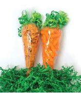 1)  Take a 7x15 cone bag. 2)  Fill ¾ with cheese puffs or small cheddar type crackers. 3)  Secure the top of the bag closed by twisting and then tying a ribbon knot very tight.  (You can add ribbon curls by using a ribbon shredder).  4)  Place carrots on top of green shred in your favorite Easter basket.
